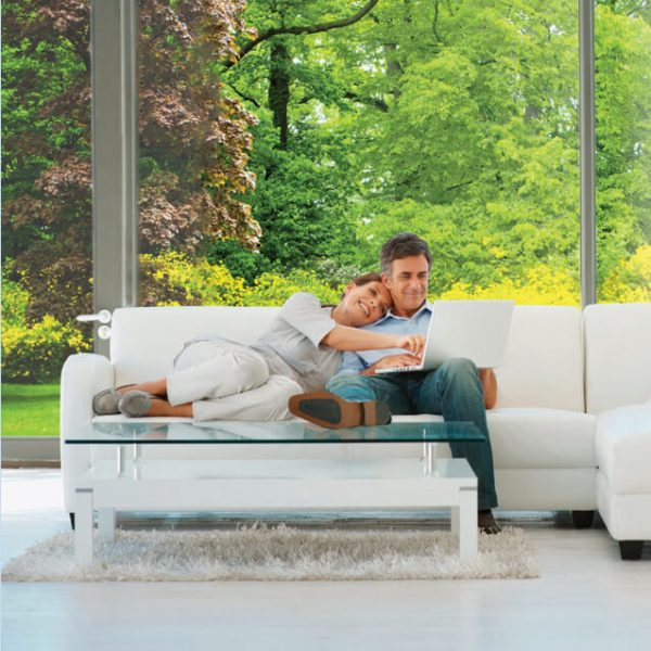 Panorama window film for solar safety shown in living room with couple