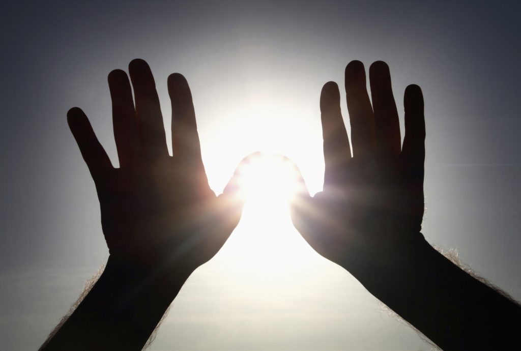 shielding the sun with hands