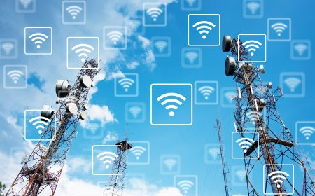 WiFi network on antennas on the top of a hill with blue sky background. Technology and communication 4.0 concept.