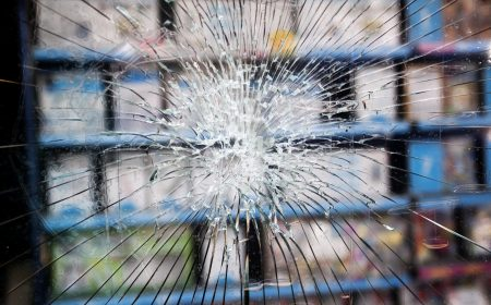 The felon who tried to break into this shop had no success - the toughened glass prevented it.